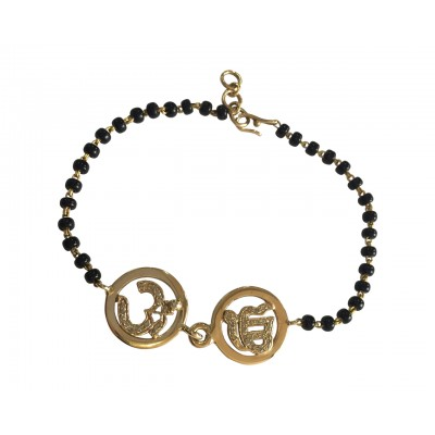Om & Ik Onkaar joint bracelet in gold on mangal sutra chain
