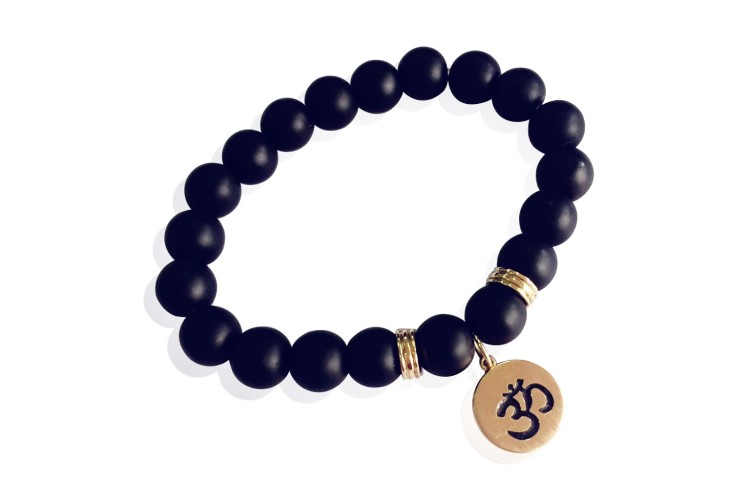 Aum bracelet in 14k gold on onyx beads