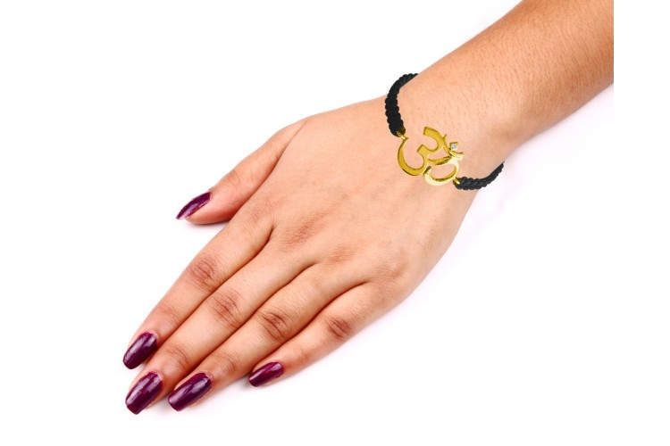 Auspicious Calligraphic Om Bracelet in 14k gold with diamond