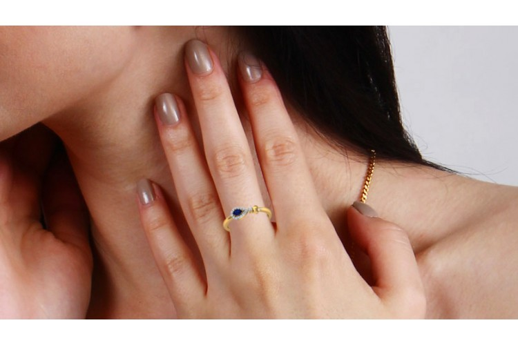 Buy Anchita Sapphire Ring in 14k hallmarked gold and studded with a Pear Shape Natural Sapphire and Diamonds